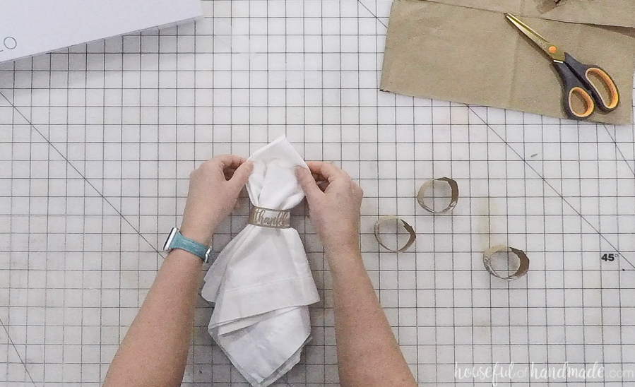 paper thankful napkin ring added to white cloth napkin