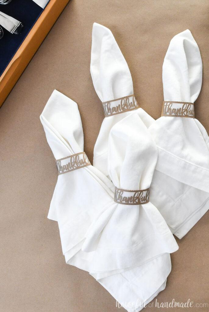 4 diy thankful paper napkin rings with white napkins