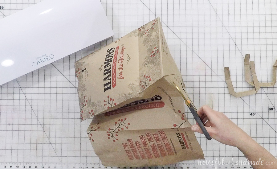 cutting out paper bag for diy thankful napkin rings