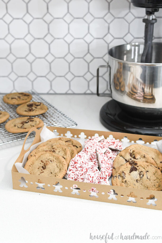 one paper christmas cookie tray on counter with mixer