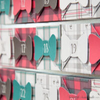 Close up of the plaid boxes on the Christmas advent calendar.