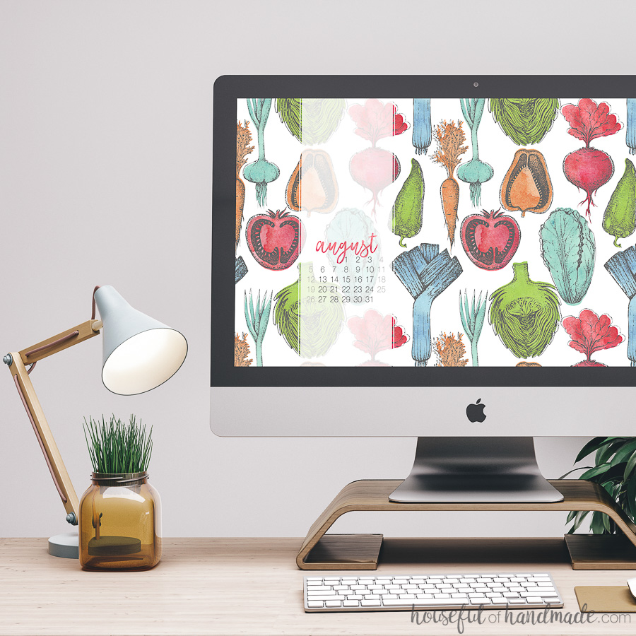 iMac desktop computer with free digital backgrounds for August on it. Watercolor vegetable pattern with blue, green, orange and red, designs.