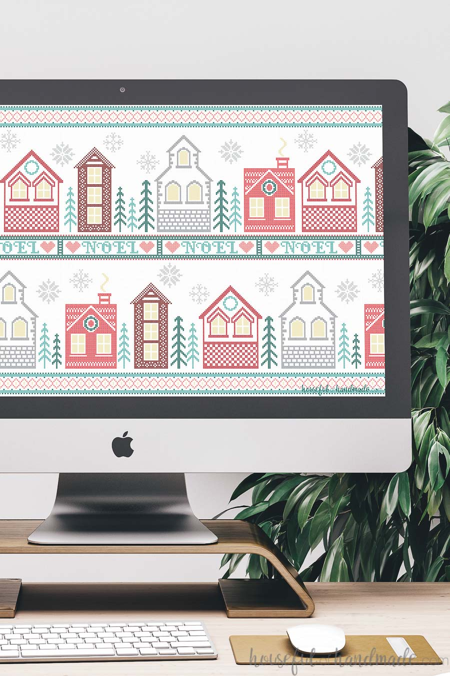 Desktop computer with the Christmas themed free digital background on it.