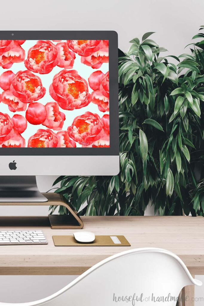 iMac computer with bold peony digital wallpaper as the free digital background for March.