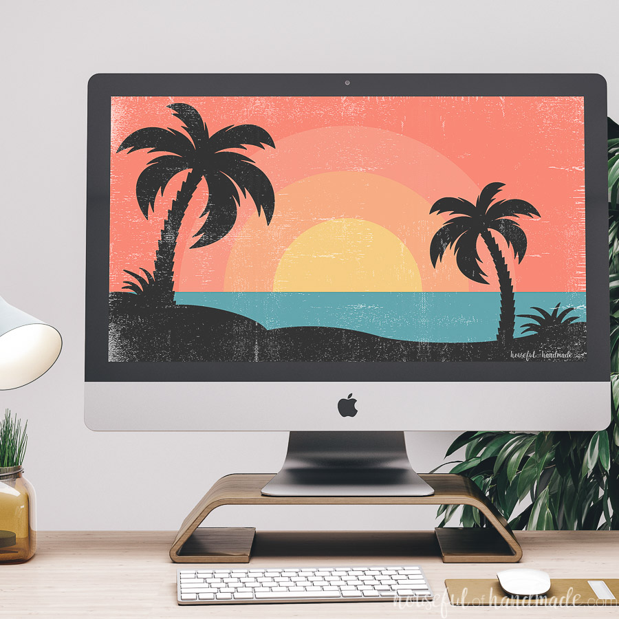 iMac computer on a desk with a summer digital background on it.
