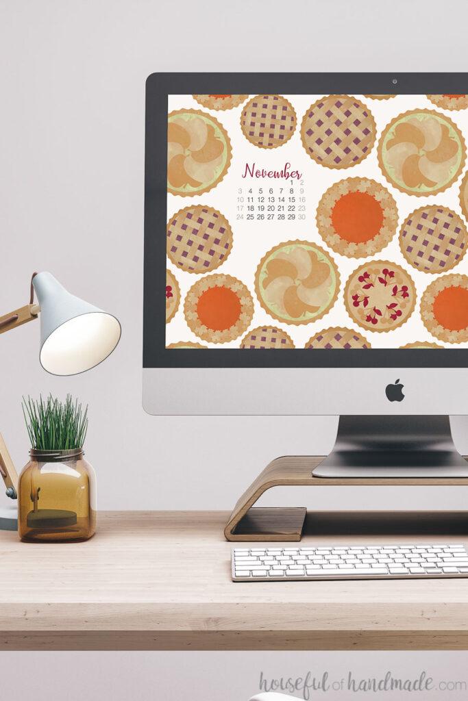 Free digital wallpaper for November with the November calendar on the screen of a desktop computer.