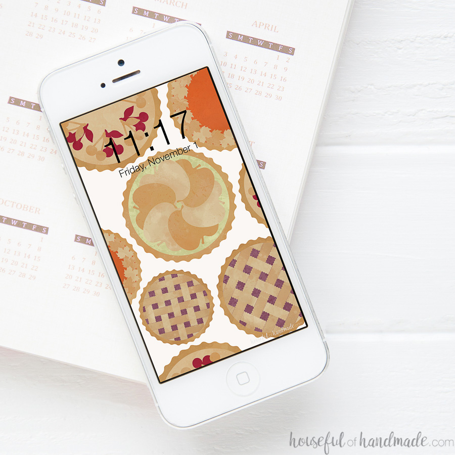 White iPhone with pie pattern digital wallpaper on the screen.