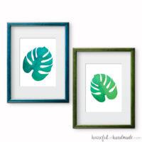 Two printable tropical leaf prints in frames.