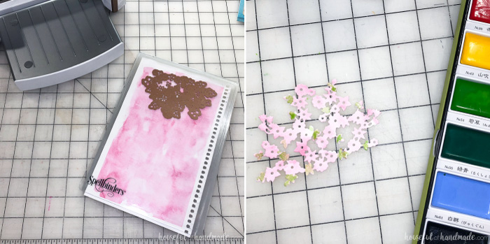 cutting out watercolor flowers for spring candle diy