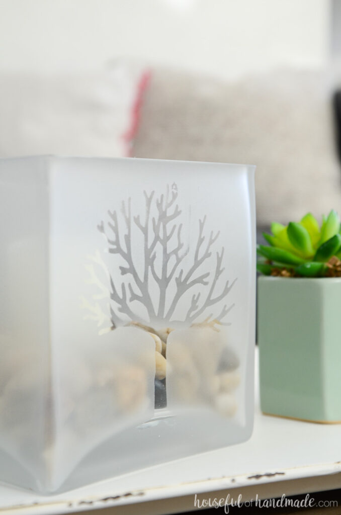 close up of spring glass candle holder on table