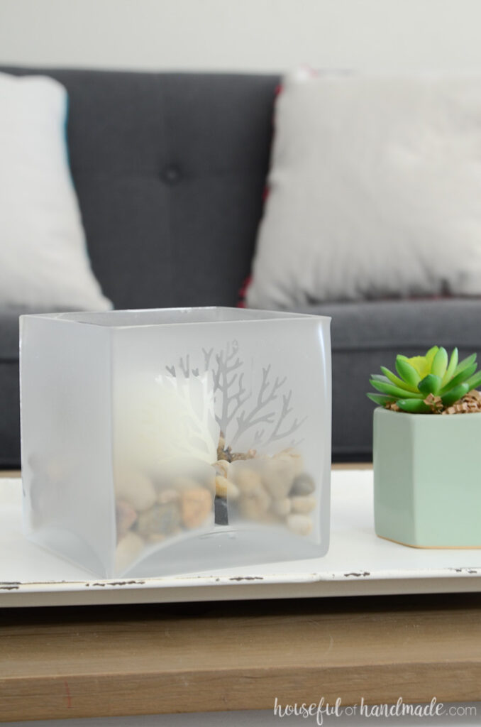 glass candle holder for spring on table with succulent