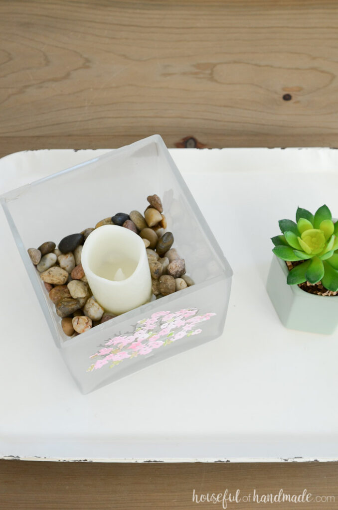 top of spring glass candle holder with rocks and candle