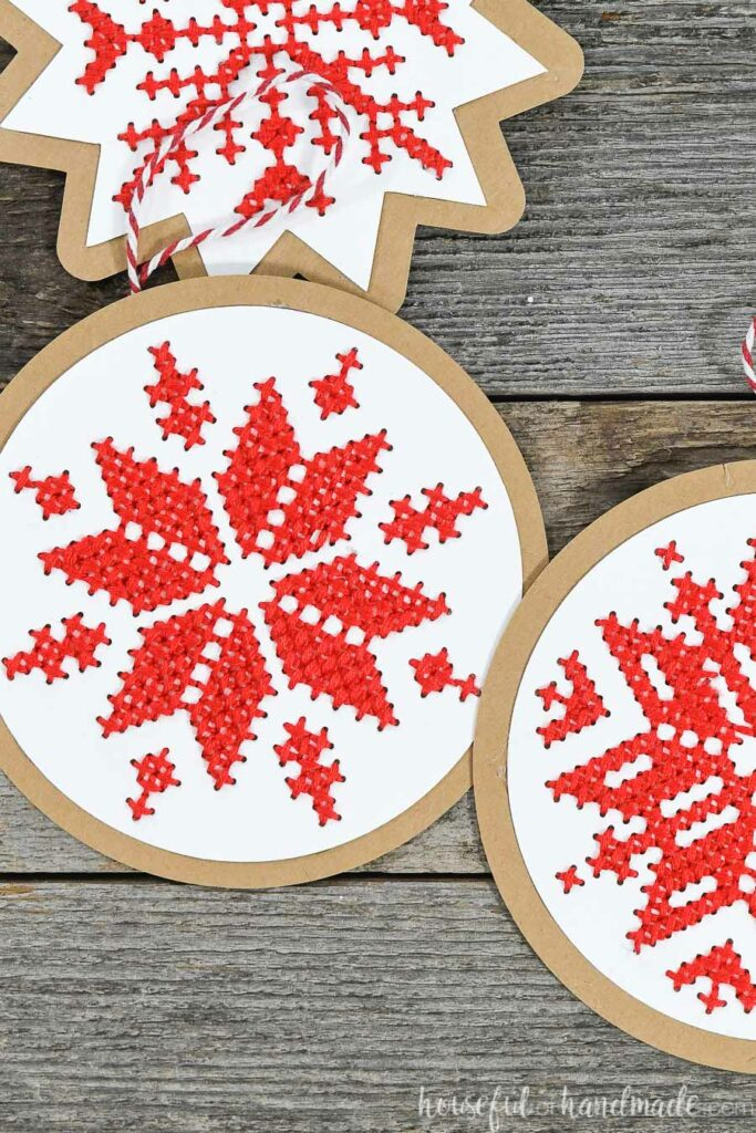 close up of nordic cross stitch ornaments on wood background