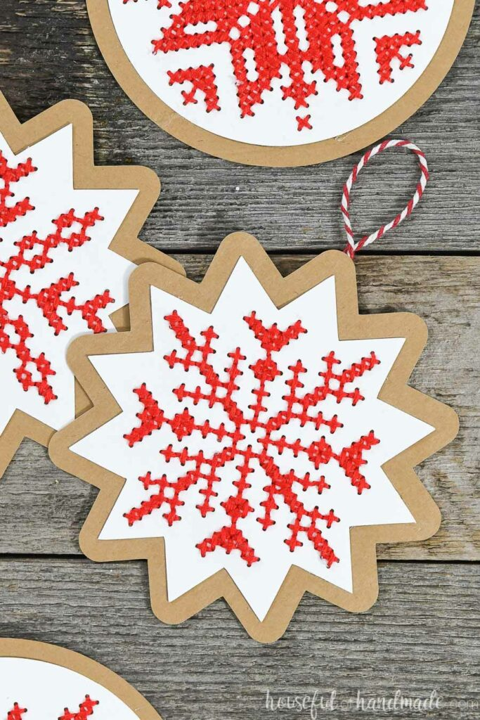 nordic cross stitch Christmas ornaments on wood background