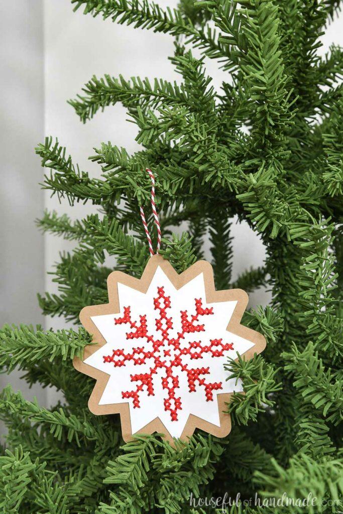nordic cross stitch ornament hanging on Christmas tree