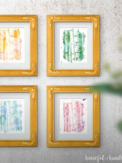 Four frames with printable aspen tree art on a wall
