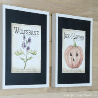 Two printable Halloween art pieces in a frame