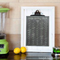 This printable recipe scaling chart is the perfect kitchen helper tool. Includes measurements to help you 1/3, half, 1 1/2 and double a recipe. Cute chalkboard printable on a white beadboard picture frame.