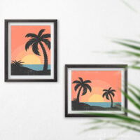 Two tropical sunset art prints in black frames hanging on the wall.