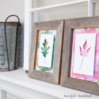 Two rustic frames with water color leaf art