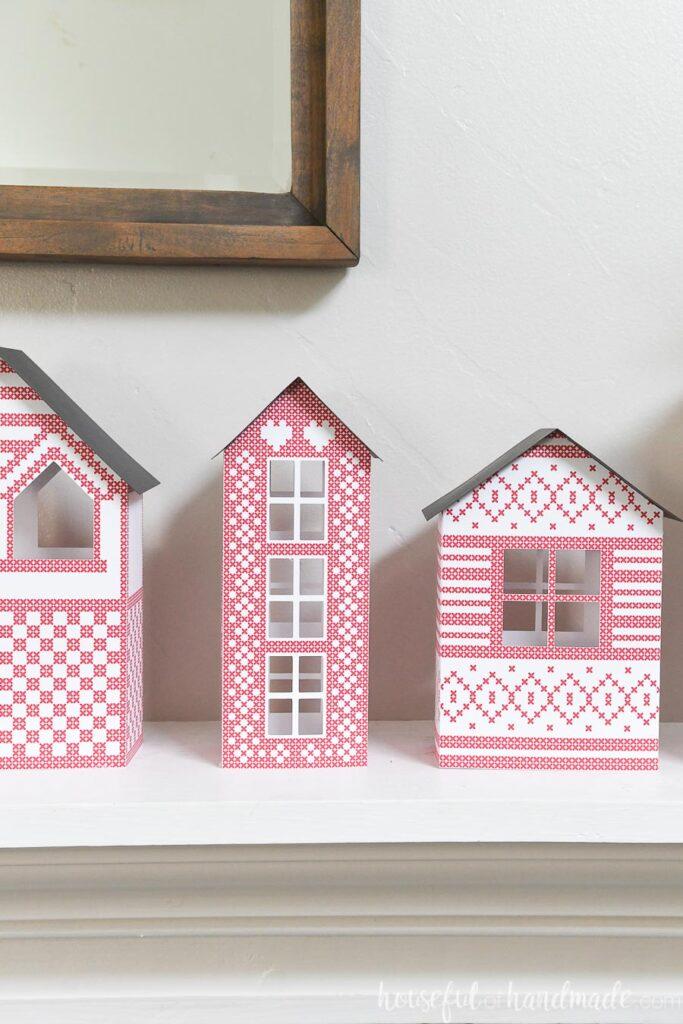 Scandinavian Paper Christmas Village set of 3 on mantel