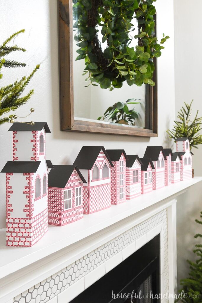 side view of paper Christmas village on mantel