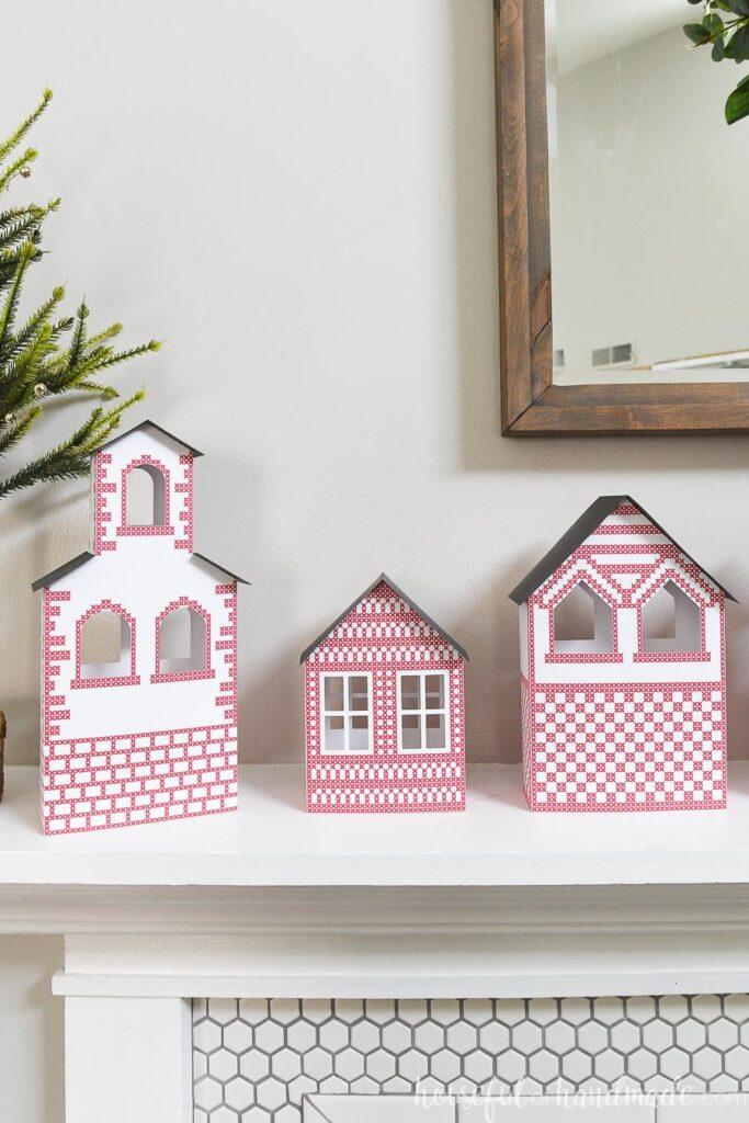Scandinavian Paper Christmas Village on mantel