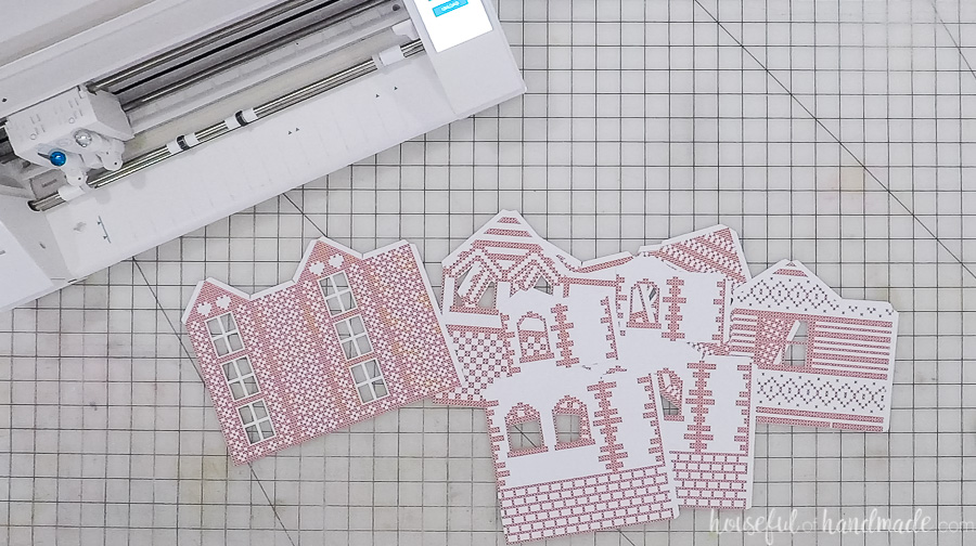 cut out paper village houses with silhouette