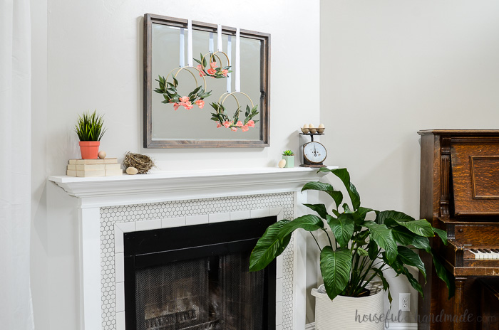 fireplace mantel decorated for spring with spring hoop wreaths