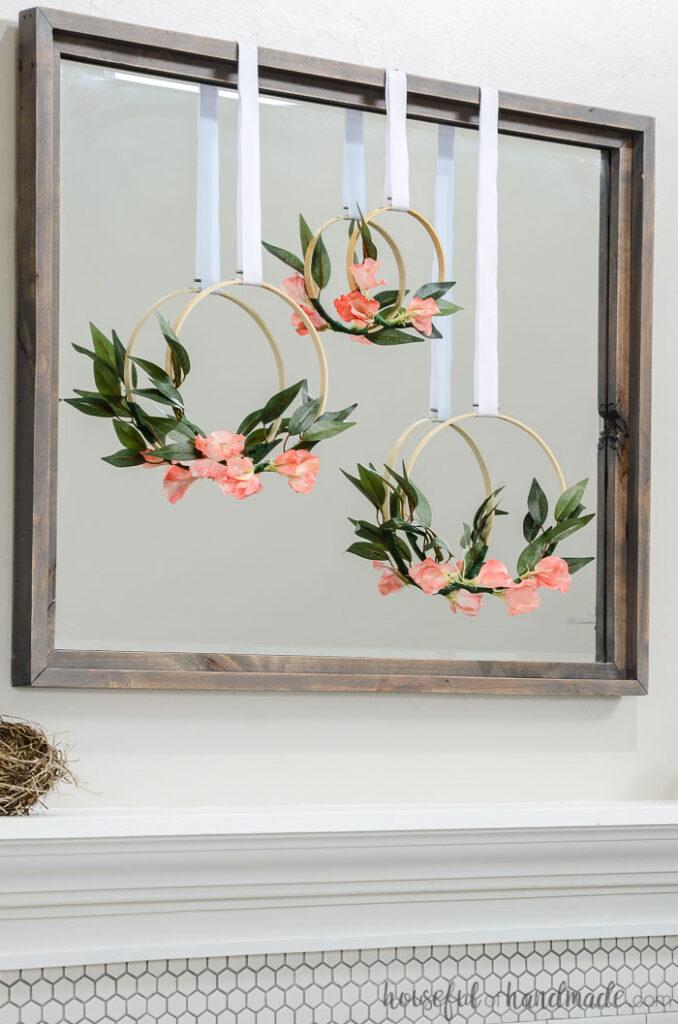 3 spring hoop wreaths on mirror over mantel