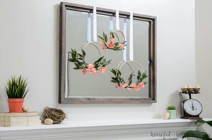 large mirror with 3 spring hoop wreaths over mantel