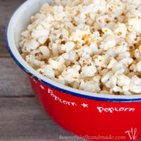 Red popcorn tub filled with brown butter and honey popcorn.