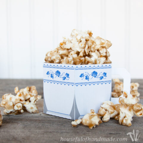 Paper cup designed to look like a china tea cup filled with chai spiced caramel popcorn.
