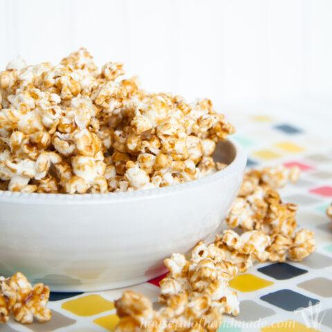 caramel popcorn in white bowl on table