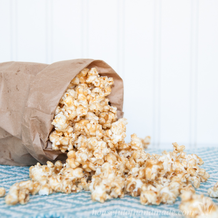 Chewy Peanut Butter Caramel Popcorn in brown bag