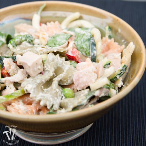 Healthy creamy italian pasta salad in a glazed bowl.