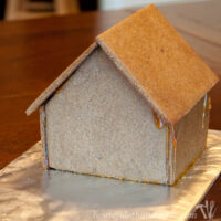 gingerbread house on counter on foil tray