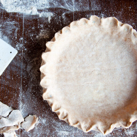 whole wheat pie crust on counter with flour