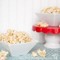 Vanilla Bean Cheesecake Caramel Popcorn in white bowl