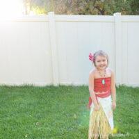 Little girl wearing DIY moana costume in the backyard.