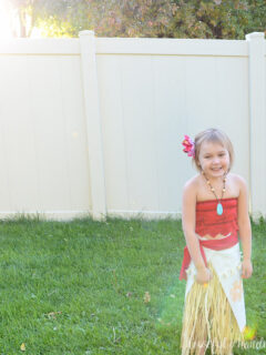 Little girl wearing DIY moana costume in the backyard.