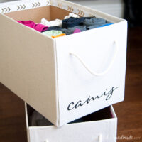 Boxes covered with drop cloth to make beautiful storage boxes for the home.