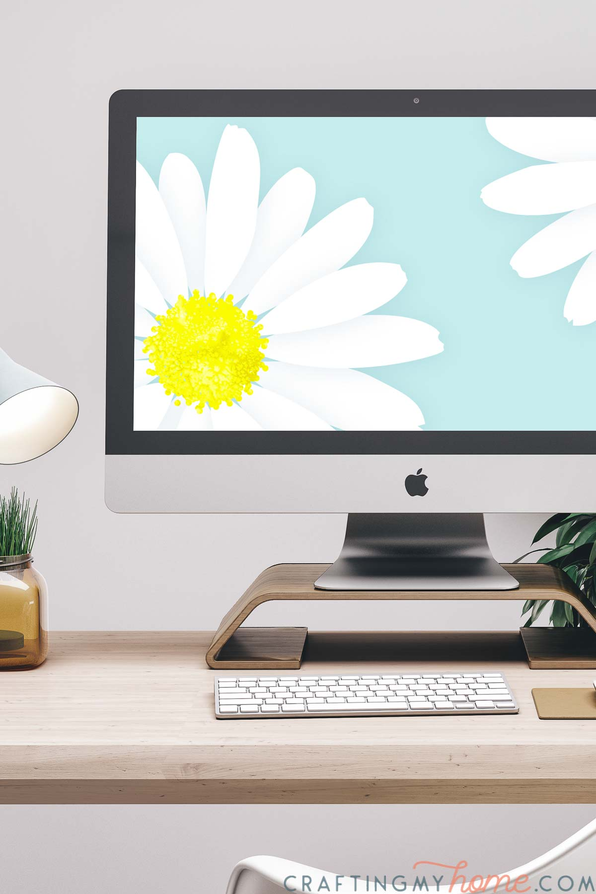 iMac computer on a desk with the giant daisy print on the screen as a digital wallpaper.