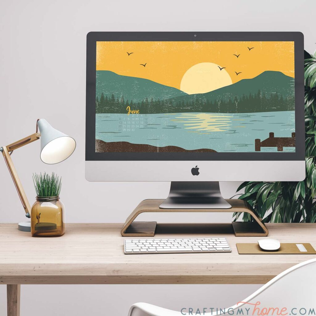 iMac computer on a monitor stand with the lake art digital background on the screen.